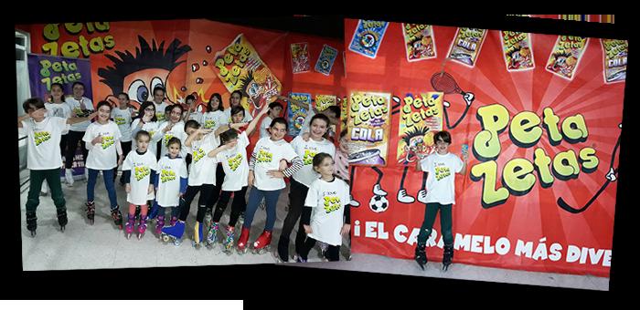 Niños disfrutando la Fiesta del niño frente a una pancarta de Peta Zetas